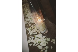 Aisle decoration with petals and candles
