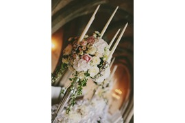 Candleholders with white and pale pink roses for wedding banquet