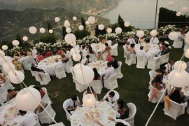Decoration with white paper lanterns for outdoor wedding reception