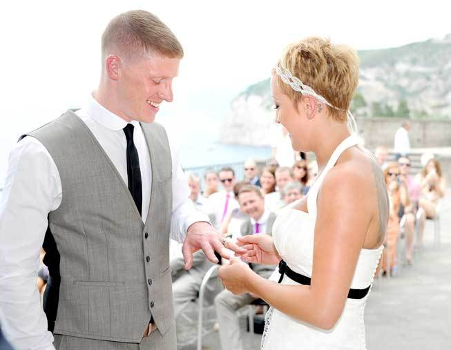 Exchange of the rings during civil ceremony in Sorrento