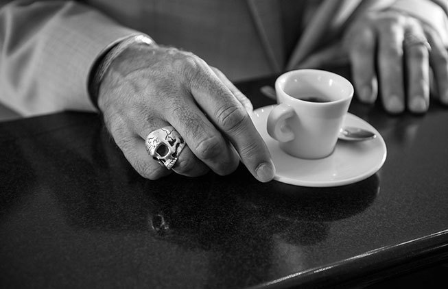 Groom having an espresso in a typical Italian cafe