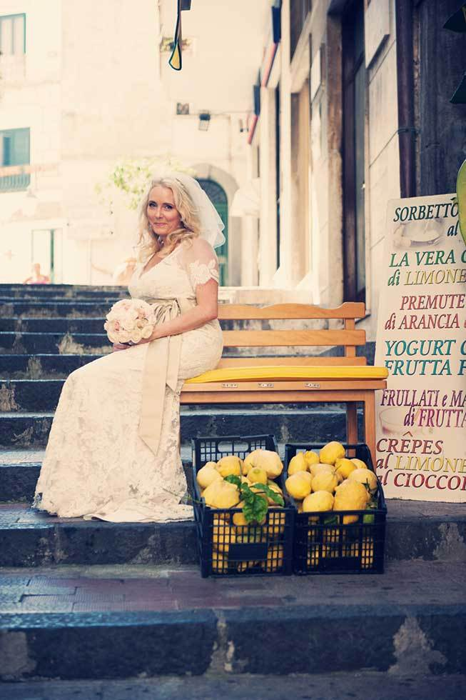 Portrait of a bride in front of a fruit stand in Atrani