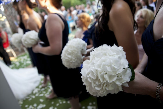 Bridesmaids' bouquets in total white