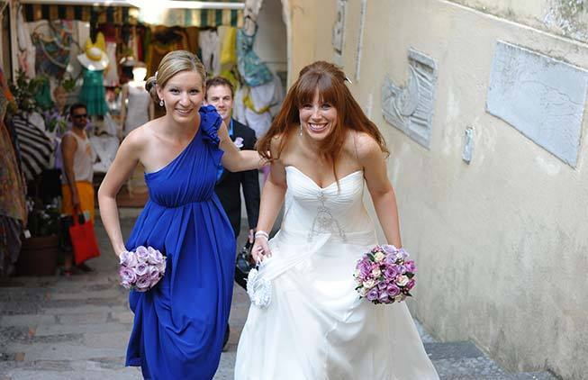 Bride and bridesmaid walking in the streets of Positano