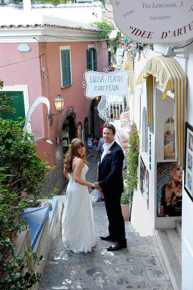 Bridal couple strolling in the streets of Positano