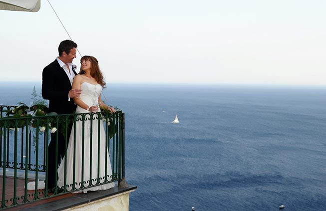 Bridal couple on a terrace with seaview in Positano
