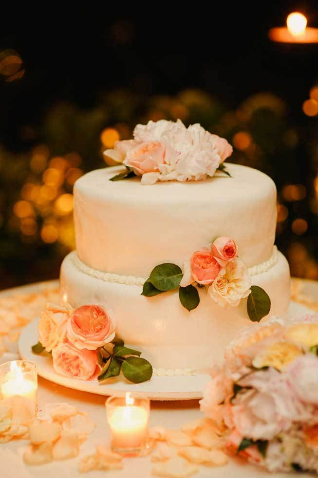 Wedding cake with orange roses for wedding on the Amalfi Coast of Italy