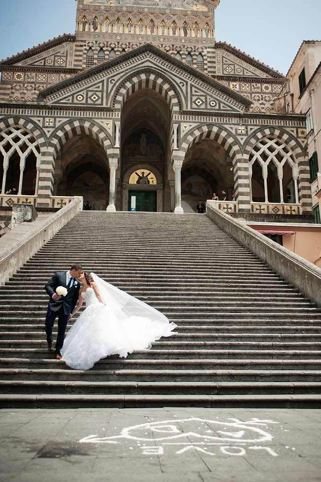 Bride and groom in front of the Amalfi Duomo