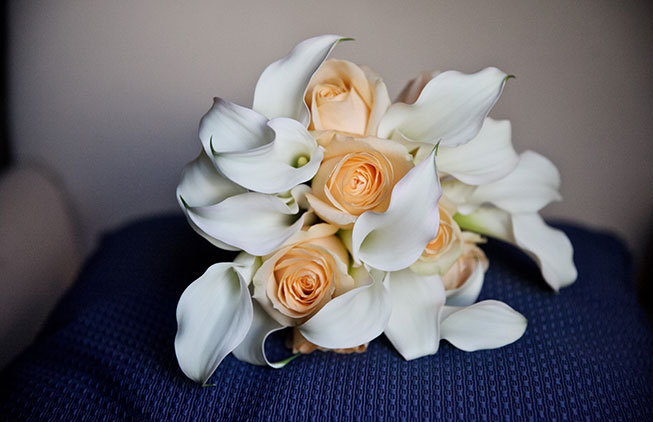 Bridal bouquet with orange roses white calla lilies