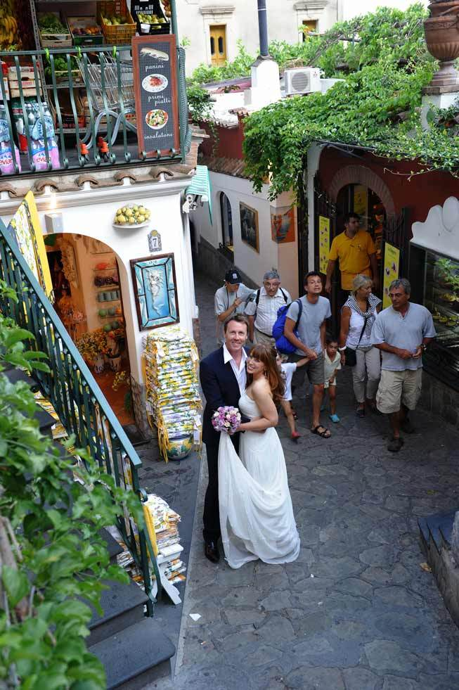 Bridal couple walking in the streets of Positano