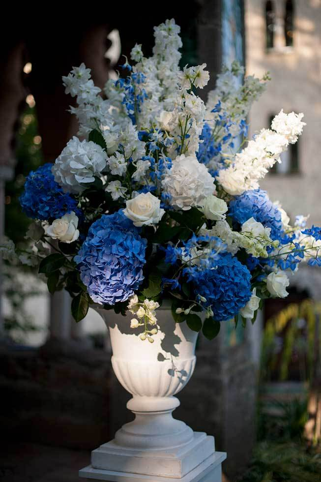 Flower decoration in white and blue for wedding ceremony in Ravello