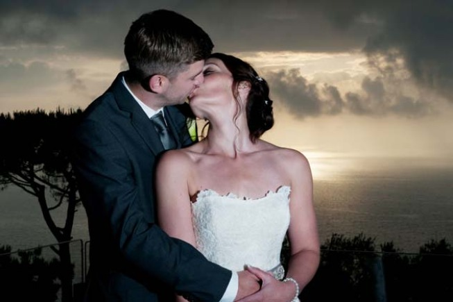 Romantic kiss of a bridal couple in Sorrento