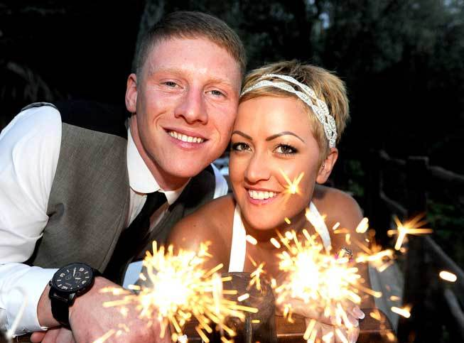 Bridal couple with sparklers at a wedding reception in Sorrento